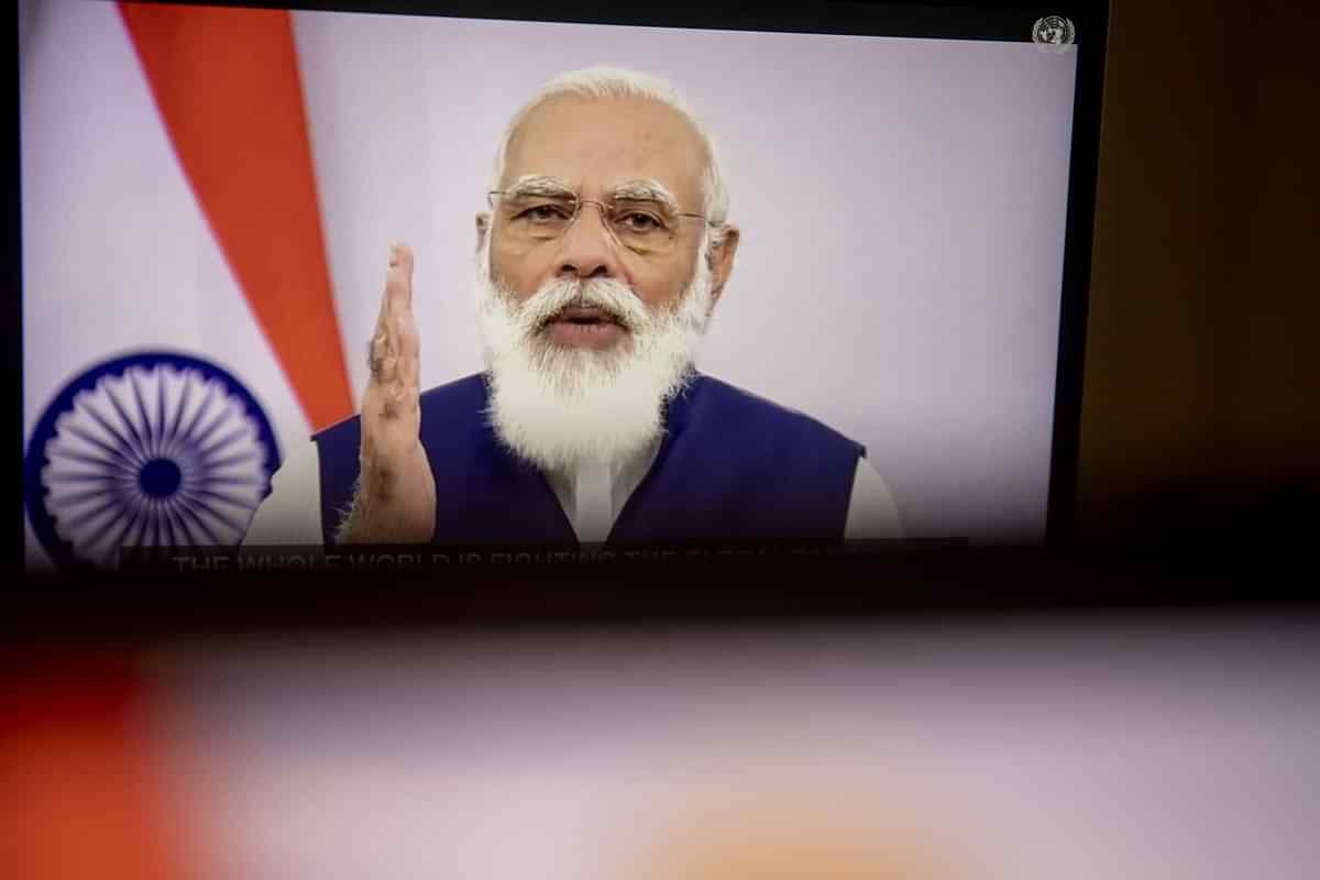 Narendra Modi, India's prime minister, speaks during the United Nations General Assembly seen on a laptop computer in Tiskilwa, Illinois, U.S. (Photographer: Daniel Acker/Bloomberg)